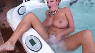 Kelly Madison enjoys solo sexual adventures while being unfurnished