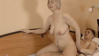 Milf mature jumps on the one-eyed snake of a 18-years-old boy